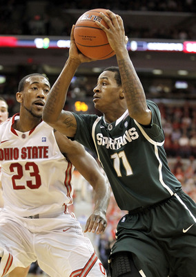 COLUMBUS, OH - FEBRUARY 15:  Keith Appling #11 of the Michigan State Spartans drives past David Lighty #23 of the Ohio State Buckeyes during the first half on February 15, 2011 at Value City Arena in Columbus, Ohio.  (Photo by Gregory Shamus/Getty Images)
