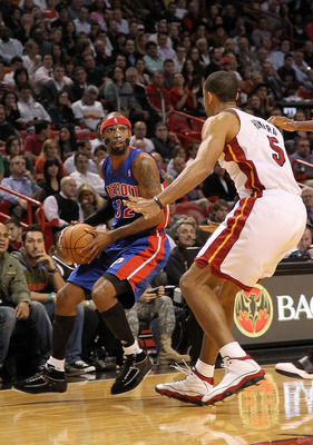 MIAMI, FL - DECEMBER 01:  Richard Hamilton #32 of the Detroit Pistons looks to pass the ball away from Juwan Howard #5 of the Miami Heat during a game at American Airlines Arena on December 1, 2010 in Miami, Florida. NOTE TO USER: User expressly acknowled