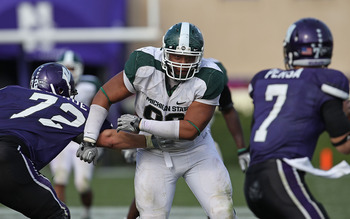 EVANSTON, IL - OCTOBER 23: Jerel Worthy #99 of the Michigan State Spartans moves past a block attempt by Brian Mulroe #72 of the Northwestern Wildcats with his sights set on Dan Persa #7 at Ryan Field on October 23, 2010 in Evanston, Illinois. Michigan St