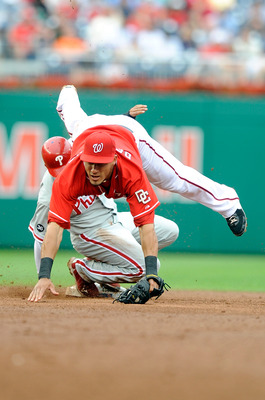 WASHINGTON - AUGUST 01:  Wilson Valdez #21 of the Philadelphia Phillies slides safely into second base under the tag of Ian Desmond #6 of the Washington Nationals at Nationals Park on August 1, 2010 in Washington, DC. The Phillies won the game 6-4.  (Phot