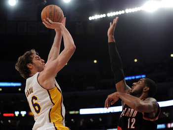 LOS ANGELES, CA - NOVEMBER 07:  Pau Gasol #16 of the Los Angeles Lakers shoots a jumper over LaMarcus Aldridge #12 of the Portland Trail Blazers at the Staples Center on November 7, 2010 in Los Angeles, California.  NOTE TO USER: User expressly acknowledg