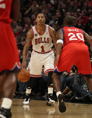 CHICAGO, IL - DECEMBER 21: Derrick Rose #1 of the Chicago Bulls moves against Jodie Meeks #20 of the Philadelphia 76ers at the United Center on December 21, 2010 in Chicago, Illinois. The Bulls defeated the 76ers 121-76. NOTE TO USER: User expressly ackno