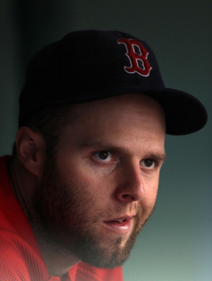 BOSTON - AUGUST 22:  Dustin Pedroia #15 of the Boston Red Sox sits in the dugout during the game against the Toronto Blue Jays on August 22, 2010 at Fenway Park in Boston, Massachusetts.  (Photo by Elsa/Getty Images)
