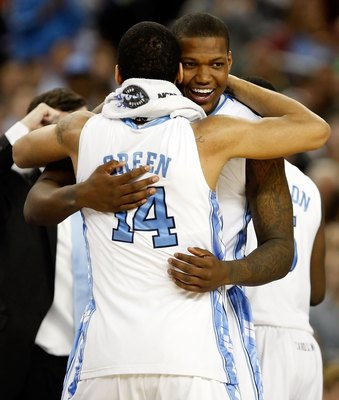 DETROIT - APRIL 06:  Deon Thompson #21 and Danny Green #14 of the North Carolina Tar Heels celebrate after the Tar Heels 89-72 win against the Michigan State Spartans during the 2009 NCAA Division I Men's Basketball National Championship game at Ford Fiel