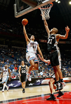 MEMPHIS, TN - APRIL 25:  Shane Battier #31 of the Memphis Grizzlies drives to the basket against Tim Duncan #21 of the San Antonio Spurs during Game four of Western Conference Quarterfinals of the 2004 NBA Playoffs April 25, 2004 at The Pyramid in Memphis
