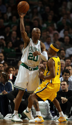 BOSTON - FEBRUARY 27:  Ray Allen #20 of the Boston Celtics passes the ball under pressure from T.J. Ford #5 of the Indiana Pacers on February 27, 2009 at TD Banknorth Garden in Boston, Massachusetts.The Celtics defeated the Pacers 104-99. NOTE TO USER: Us