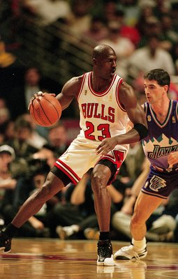 I3 Jun 1997:  Michael Jordan #23 of the Chicago Bulls dribbles the ball as he is guarded by John Stockton #12 of the Utah Jazz during game six of the NBA Final at the United Center in Chicago, Illinois. The Bulls defeated the Jazz 90-86..   Mandatory Cred