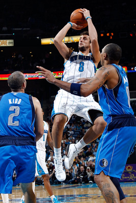 NEW ORLEANS - NOVEMBER 17:  Marco Belinelli #8 of the New Orleans Hornets shoots the ball over Shawn Marion #0 of the Dallas Mavericks at the New Orleans Arena on November 17, 2010 in New Orleans, Louisiana.  NOTE TO USER: User expressly acknowledges and