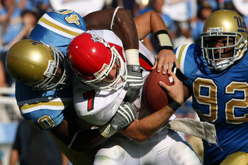 PASADENA, CA - SEPTEMBER 27:  Quarterback Tom Brandstater #7 of the Frenso State Bulldogs is sacked by Akeem Ayers #40 of the UCLA Bruins during the game on September 27, 2008 at the Rose Bowl in Pasadena, California.  Fresno State defeated UCLA 36-31.  (