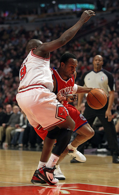 CHICAGO, IL - DECEMBER 21: Andre Iguodala #9 of the Philadelphia 76ers drives against Loul Deng #9 of the Chicago Bulls at the United Center on December 21, 2010 in Chicago, Illinois. The Bulls defeated the 76ers 121-76. NOTE TO USER: User expressly ackno