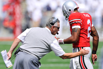 COLUMBUS, OH - SEPTEMBER 05:  Head coach Jim Tressel of the Ohio State Buckeyes congratulates his quarterback Terrelle Pryor #2 after the Buckeyes added another touchdown against the Navy Midshipmen at Ohio Stadium on September 5, 2009 in Columbus, Ohio.