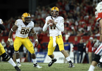 TUCSON, AZ - DECEMBER 02:  Quarterback Brock Osweiler #17 of the Arizona State Sun Devils scrambles with the football during the college football game at Arizona Stadium on December 2, 2010 in Tucson, Arizona. The Sun Devils defeated the Wildcats 30-29 in
