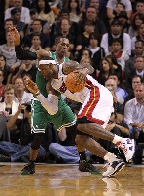 MIAMI - NOVEMBER 11:  LeBron James #6 of the Miami Heat drives against Rajon Rondo #9 during a game against the Boston Celtics at American Airlines Arena on November 11, 2010 in Miami, Florida. NOTE TO USER: User expressly acknowledges and agrees that, by