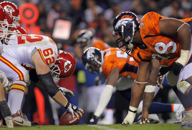 DENVER - NOVEMBER 14:  Center Casey Wiegman #62 of the Kansas City Chiefs snaps the ball as the Chiefs offensive line takes on the defensive line of the Denver Bronco at INVESCO Field at Mile High on November 14, 2010 in Denver, Colorado. The Broncos defe