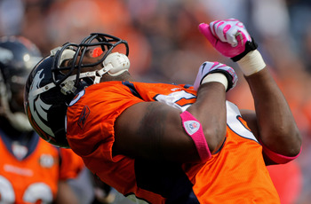 DENVER - OCTOBER 04:  Linebacker Robert Ayers #56 of the Denver Broncos celebrates a defensive play against the Dallas Cowboys during NFL action at Invesco Field at Mile High on October 4, 2009 in Denver, Colorado. The Broncos defeated the Cowboys 17-10.