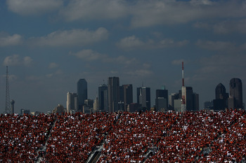 DALLAS - OCTOBER 11:  Texas Longhorns fans fill the stands in front of the Dallas skyline during a game between the Oklahoma Sooners and the Texas Longhorns at the Cotton Bowl on October 11, 2008 in Dallas, Texas.  (Photo by Ronald Martinez/Getty Images)