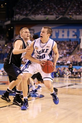 INDIANAPOLIS - APRIL 05:  Jon Scheyer #30 of the Duke Blue Devils drives against Zach Hahn #3 of the Butler Bulldogs during the 2010 NCAA Division I Men's Basketball National Championship game at Lucas Oil Stadium on April 5, 2010 in Indianapolis, Indiana
