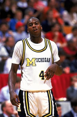Glen Rice #4 of the University of Michigan Wolverines walks on the court.