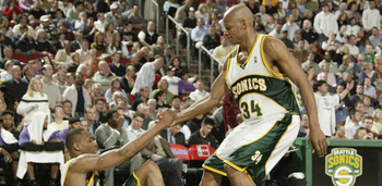 SEATTLE - APRIL 23:  Rashard Lewis #7 of the Seattle SuperSonics is helped off the floor by teammate Ray Allen #34 in Game one of the Western Conference Quarterfinals against the Sacramento Kings during the 2005 NBA Playoffs on April 23, 2005 at Key Arena