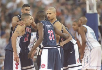 29 Mar 1997:  Guards Mike Bibby, Jason Terry and Miles Simon of the Arizona Wildcats speak to one another during an NCAA Final Four game against the North Carolina Tarheels at the RCA Dome in Indianapolis, Indiana.  Arizona won the game 66 - 58. Mandatory