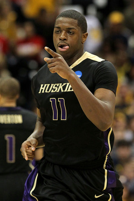 SYRACUSE, NY - MARCH 25:  Matthew Bryan-Amaning #11 of the Washington Huskies reacts in the first half against the West Virginia Mountaineers during the east regional semifinal of the 2010 NCAA men's basketball tournament at the Carrier Dome on March 25,