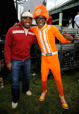NEW YORK - SEPTEMBER 26:  Former NFL player and TV personality Tiki Barber and  DJ Lance Rock pose backstage at Nickelodeon's Sixth Annual Worldwide Day of Play with NYC Big Brothers and Big Sisters at Riveride Park on September 26, 2009 in New York City.