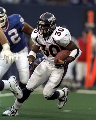 13 Dec 1998: Running back Terrell Davis #30 of the Denver Broncos in action during the game against the New York Giants at Giants Stadium in East Rutherford, New Jersey. The Giants defeated the Broncos 21-16.