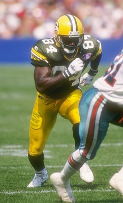 11 Sep 1994:  Wide receiver Sterling Sharpe of the Green Bay Packers  (left) runs a pass pattern during a game against the Miami Dolphins at Milwaukee County Stadium in Milwaukee, Wisconsin.  The Dolphins won the game, 24-14. Mandatory Credit: Jonathan Da