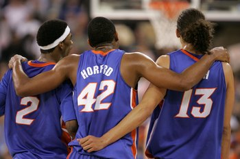 INDIANAPOLIS - APRIL 03:  Al Horford #42 puts his arms around teammates Corey Brewer #2 and Joakim Noah #13 of the Florida Gators as they celebrate in the final seconds of the game before defeating the UCLA Bruins 73-57 during the National Championship ga