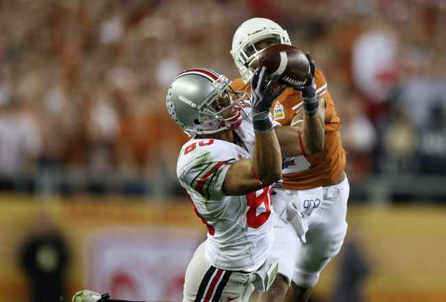 GLENDALE, AZ - JANUARY 05:  Wide receiver Brian Robiskie #80 of the Ohio State Buckeyes makes a diving 48 yard reception past Curtis Brown #3 of the Texas Longhorns during the Tostitos Fiesta Bowl Game on January 5, 2009 at University of Phoenix Stadium i