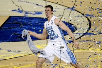 DETROIT - APRIL 06:  Tyler Hansbrough #50 of the North Carolina Tar Heels celebrates with his teammates after they won 89-72 against the Michigan State Spartans during the 2009 NCAA Division I Men's Basketball National Championship game at Ford Field on A