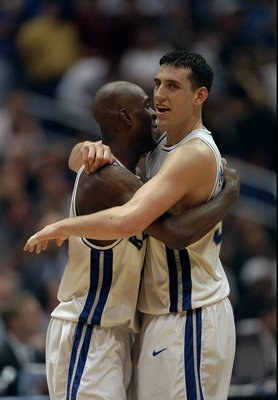 30 Mar 1998:  Guard Scott Padgett and forward Heshimu Evans of the Kentucky Wildcats in action during a playoff game against the Utah Utes at the Alamodome in San Antonio, Texas.  Kentucky won the game, 78-69. Mandatory Credit: Todd Warshaw  /Allsport