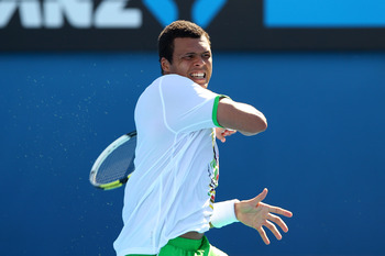 MELBOURNE, AUSTRALIA - JANUARY 20:  Jo-Wilfried Tsonga of France plays a forehand in his second round match against Andreas Seppi of Italy during day four of the 2011 Australian Open at Melbourne Park on January 20, 2011 in Melbourne, Australia.  (Photo b