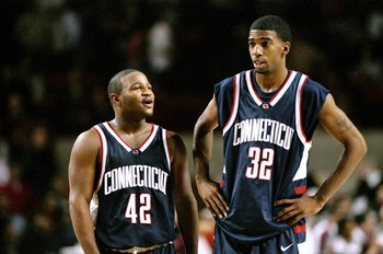 9 Dec 1998:  Guard Khalid El-Amin #42 and guard/forward Richard Hamilton #32 of the UConn Huskies confer during the game against the UMass Minutemen at Mullins Center in Amherst, Massachusetts. UConn defeated UMass 59-54. Mandatory Credit: Ezra O. Shaw  /