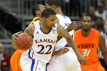 KANSAS CITY, MO - MARCH 10:  Marcus Morris #22 of the Kansas Jayhawks drives with the ball against the Oklahoma State Cowboys during their quarterfinal game in the 2011 Phillips 66 Big 12 Men's Basketball Tournament at Sprint Center on March 10, 2011 in K