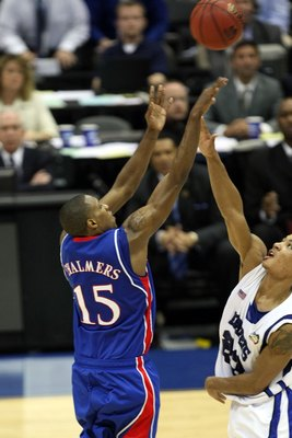 SAN ANTONIO - APRIL 07:  Mario Chalmers #15 of the Kansas Jayhawks shoots and makes a three-pointer to tie the game to send it into overtime against the Memphis Tigers during the 2008 NCAA Men's National Championship game at the Alamodome on April 7, 2008