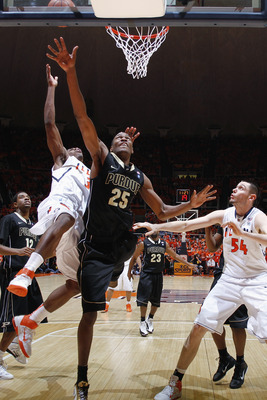 CHAMPAIGN, IL - FEBRUARY 13: JaJuan Johnson #25 of the Purdue Boilermakers goes to the basket against Brandon Paul #3 and Mike Tisdale #54 of the Illinois Fighting Illini at Assembly Hall on February 13, 2011 in Champaign, Illinois. Purdue defeated Illino