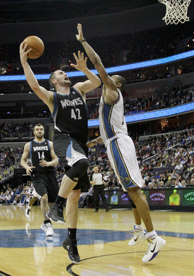 WASHINGTON, DC - MARCH 05:  Kevin Love #42 of the Minnesota Timberwolves puts up a shot over the defense of Rashard Lewis #9 of the Washington Wizards at the Verizon Center on March 5, 2011 in Washington, DC. NOTE TO USER: User expressly acknowledges and