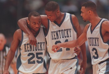 1 Apr 1996:  Anthone Epps #25, Antoine Walker #24 and Ron Mercer #33 of the Kentucky Wildcats talk together during the final of the1996 NCAA Final Four Men''s Basketball Championship against the Syracuse Orangemen at the Continental Air Arena at Meadowlan