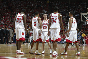 17 Feb 2002:  Steve Blake #25 of Maryland talks to teammates Juan Dixon #3 and Chris Wilcox #54 during the game against Duke at Cole Field House in College Park, Maryland . The Maryland Terrapins beat the Duke Blue Devils 87-73. DIGITAL IMAGE.Mandatory Cr