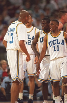 UCLA PLAYERS (FROM LEFT) TYUS EDNEY #11 AND CAMERON DOLLAR #12 CONGRATULATE CHARLES O''BANNON #13 DURING THE FIRST HALF OF THEIR NCAA FINAL FOUR GAME VERSUS OKLAHOMA STATE AT THE KINGDOME IN SEATTLE, WASHINGTON. UCLA WON 74-61 AND ADVANCES TO THE CHAMPION