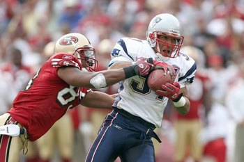 SAN FRANCISCO - OCTOBER 5:  Rodney Harrison #37 of the New England Patriots grips the ball as he is grabbed by Arnaz Battle #83 of the San Francisco 49ers during an NFL game on October 5, 2008 at Monster Park in San Francisco, California.