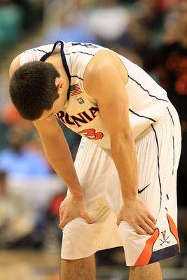 GREENSBORO, NC - MARCH 10:  Sammy Zeglinski #13 of the Virginia Cavaliers reacts in overtime during the first round of the 2011 ACC men's basketball tournament at the Greensboro Coliseum on March 10, 2011 in Greensboro, North Carolina.  Miami won 69-62 in