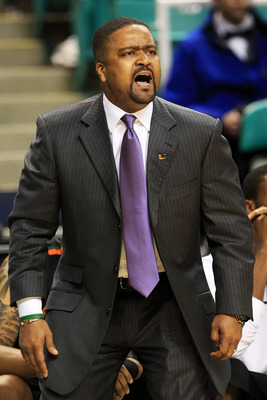 GREENSBORO, NC - MARCH 10:  Head coach Frank Haith of the Miami Hurricanes communicates with the team while playing against the Virginia Cavaliers during the first round of the 2011 ACC men's basketball tournament at the Greensboro Coliseum on March 10, 2