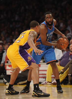 LOS ANGELES, CA - JANUARY 17:  James Harden #13 of the Oklahoma City Thunder is guarded by Derek Fisher #2 of the Los Angeles Lakers at the Staples Center on January 17, 2011 in Los Angeles, California.   NOTE TO USER: User expressly acknowledges and agre