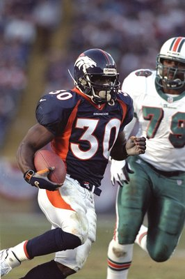 9 Jan 1999: Terrell Davis #30 of the Denver Broncos carries the ball during the AFC Play Offs against the Miami Dolphins at Mile High Stadium in Denver, Colorado. The Broncos defeated the Dolphins 38-3. Mandatory Credit: Brian Bahr  /Allsport