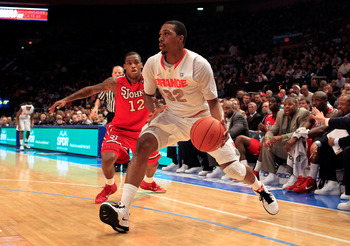 NEW YORK, NY - MARCH 10: Kris Joseph #32 of the Syracuse Orange dribbles past Dwight Hardy #12 of the St. John's Red Storm during the quarterfinals of the 2011 Big East Men's Basketball Tournament presented by American Eagle Outfitters  at Madison Square