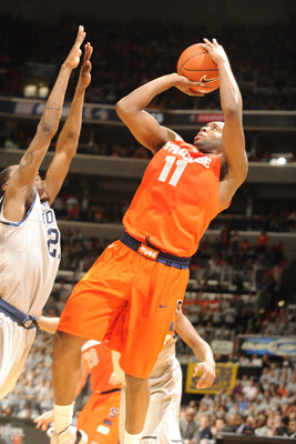 WASHINGTON, DC - FEBRUARY 26:  Scoop Jardine #11 of the Syracuse Orange takes a shot during a college basketball game against the Georgetown Hoyas on February 26, 2011 at the Verizon Center in Washington, DC  The Orange 58-51.  (Photo by Mitchell Layton/G
