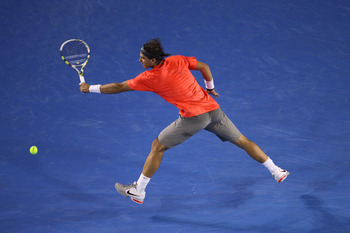 MELBOURNE, AUSTRALIA - JANUARY 26:  Rafael Nadal of Spain plays a backhand in his quarterfinal match against David Ferrer of Spain during day ten of the 2011 Australian Open at Melbourne Park on January 26, 2011 in Melbourne, Australia.  (Photo by Julian