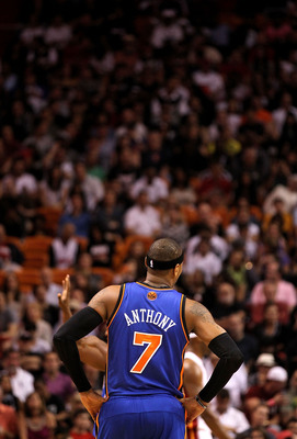 MIAMI, FL - FEBRUARY 27:  Carmelo Anthony #7 of the New York Knicks looks on during a foul shot during a game gainst the Miami Heat at American Airlines Arena on February 27, 2011 in Miami, Florida. NOTE TO USER: User expressly acknowledges and agrees tha